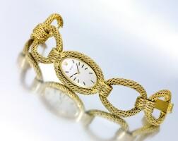 6. 勞力士(rolex) | 女裝黃金鏤空鍊帶腕錶,年份約1975。