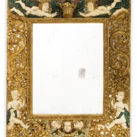 16. a carved painted and giltwood mirror, probably flemish, late 17th century |