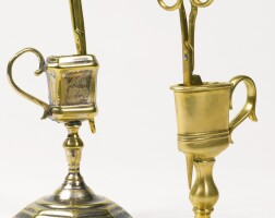 46. two english brass standing candle snuffers, one dated 1709, the other mid-18th century