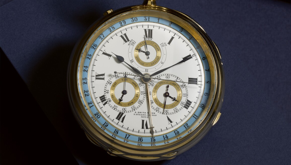 S. Smith & Son, London, An Important and Massive Gold Grande and Petite Sonnerie Two-Train Clockwatch with Trip Minute Repetition, Perpetual Calendar, Split Seconds Chronograph and Tri-Colour Dial 1903, No. 309-2.