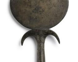 3003. an egyptian bronze mirror new kingdom, 1540-1075 bc