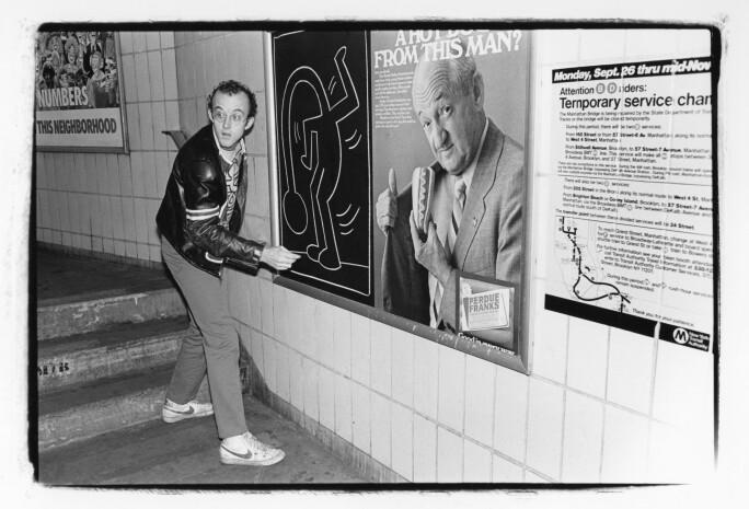 Keith Haring drawing on a subway platform in New York City, circa 1985.