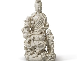 1512. a 'dehua' 'guanyin and child' group qing dynasty, 18th / 19th century |