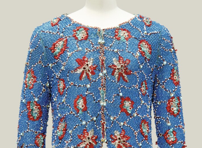 A 1960 Christian Dior blue and red chenille and pearl embroidered jacket in an auction selling luxury fashion