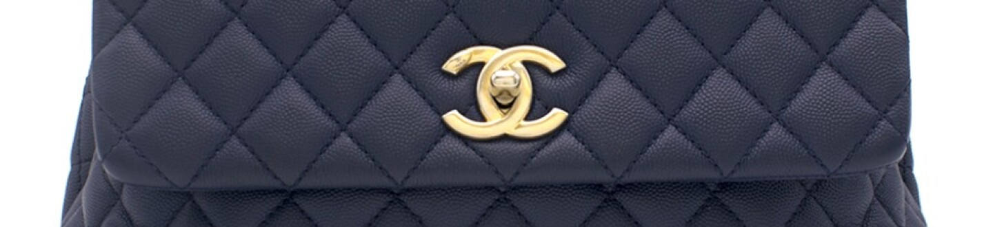 A blue Chanel bag in an auction selling luxury handbags