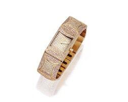 15. 18 karat two-color gold and diamond wristwatch, fred
