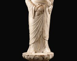 104. a finely carved white marble standing figure of a monk, probably ananda tang dynasty |