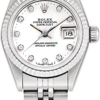 147. rolex   datejust, reference 69174 a stainless steel and diamond-set wristwatch with date, mother-of-pearl dial, white gold bezel and bracelet, circa 1985