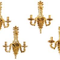 24. henri vian (1858 - 1904)a set of four french gilt-bronze twin-light wall-lights, cast, paris, last quarter 19th century |