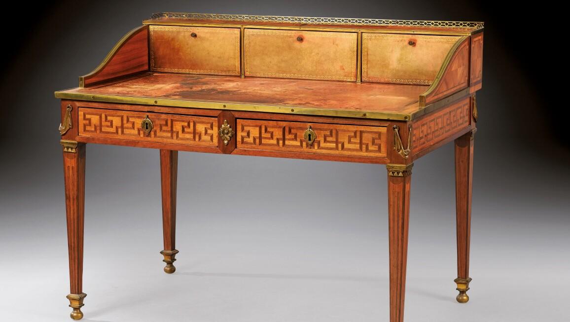 A Louis XVI tulipwood, amaranth and satiné bureau plat à gradin, stamped J.F. LELEU. Estimate €120,000 - 180,000.