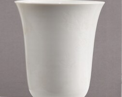 1505. a white-glazed anhua-decorated 'peony' cup qing dynasty, 18th century |