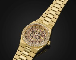5043. rolex | a yellow gold diamond-set centre seconds wristwatch with diamond sapphire and ruby-set honeycomb dial, day, date and braceletref 19048 case 6744577 oyster quartz day-date circa 1981