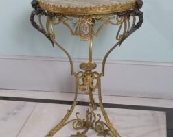 9. a napoleon iii style gilt-bronze and figured marble guéridon