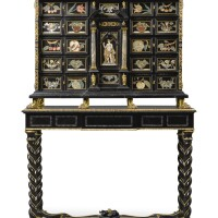 19. an italian gilt-bronze mounted ebony and ebonised pietre dure and mother-of-pearl inlaid cabinet on stand the cabinet part 18th century, the panels circa 1700, the stand late 19th century