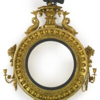 37. a regency part-ebonized giltwood convex girandole mirror circa 1815