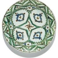 186. an iznik polychrome pottery dish with stylised pomegranates, turkey, 17th century