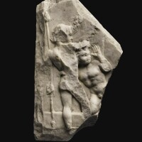 32. a roman marble relief fragment with two satyrs, 1st century a.d.   a roman marble relief fragment with two satyrs