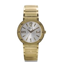 71. piaget | poloreference p10113a yellow gold automatic center seconds wristwatch with date and braceletcirca 2000