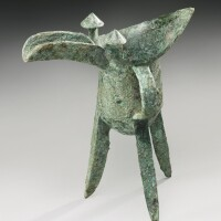 55. an archaic bronze ritual wine vessel (jue) late shang dynasty, 13th-11th century bc