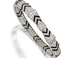 119. platinum, diamond and onyx bangle-bracelet, circa 1920