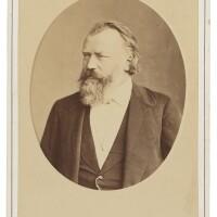 "169. brahms, johannes. fine cabinet photograph signed and inscribed ""wien johannes brahms 1 jan: 86"""