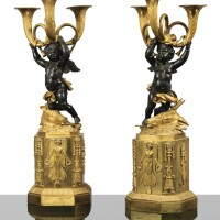 12. a pair of patinated and gilt-bronze candelabra, french empire