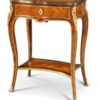 173. a louis xv style gilt-bronze mounted tulipwood table late 19th century