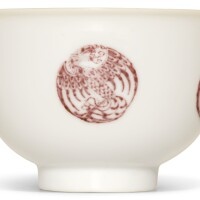 7. a copper-red 'phoenix' 'medallion' bowl kangxi mark and period