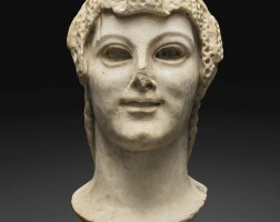 20. a roman marble archaistic head of a young woman, circa 2nd century a.d. | a roman marble archaistic head of a young woman