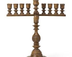 35. an olivewood hanukah lamp, probably jerusalem, 20th century