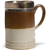 607. a london stoneware pint mug, with silver mount circa 1710 |