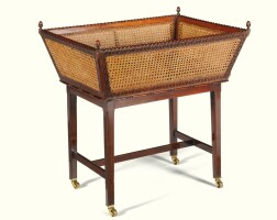 7. an edwardian carved indian rosewood and double cane basket attributed to sir edwin lutyens (1869-1944) the basket circa 1900