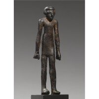 19. an egyptian copper figure of a man , 12th dynasty, 1938-1759 b.c.