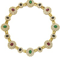 33. 18 karat two-color gold, colored stone and diamond necklace