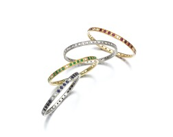 34. group of four gem set and diamond bangles