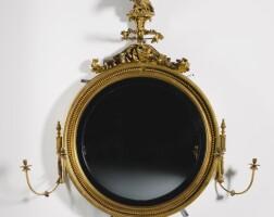 312. a regency carved giltwood convex mirror circa 1810