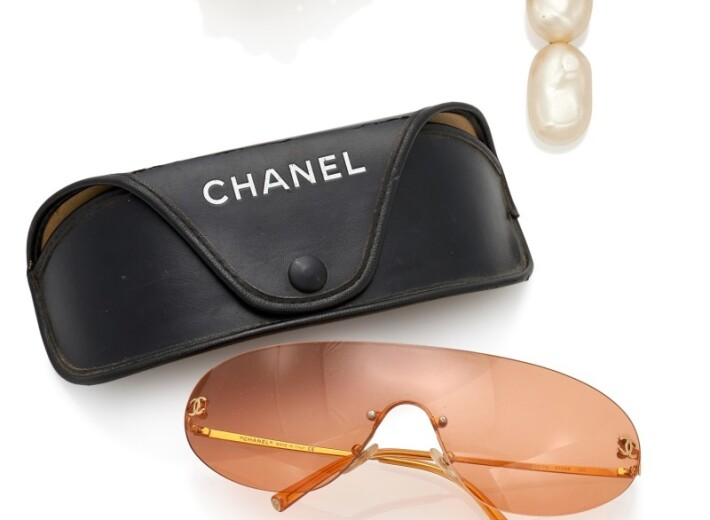 A collection of Chanel accessories sold in an auction selling luxury accessories