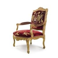 29. a régence carved giltwood fauteuil circa 1715