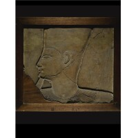 9. a limestone relief fragment , late 11th/early 12th dynasty, reign of mentuhotep ii/sesostris i, circa 1957-1875 b.c.