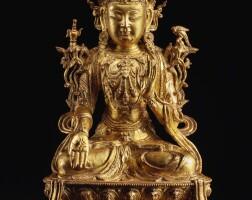 312. a largegilt-lacquer bronze figure of avalokiteshvara ming dynasty, late 15th / 16th century |