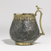 142. a silver-gilt and nielloed handled cup, persia, 11th/12th century