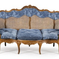 37. a louis xv walnut caned sofa, attributed to pierrenogaret  